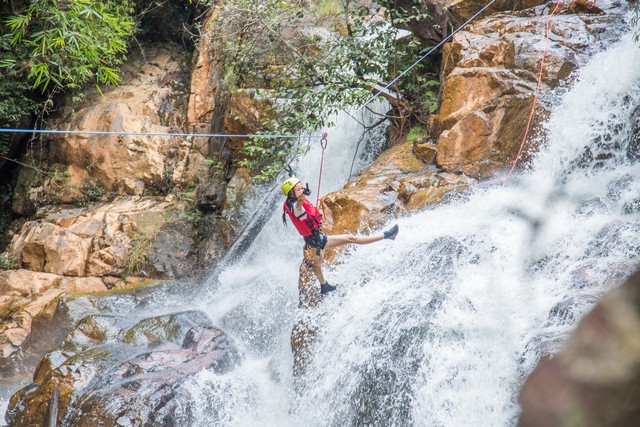 a young lady take photo during canyoning